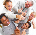 Laughing businesspeople showing thumbs up sign Stock Images