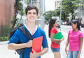 Laughing caucasian male student with friends