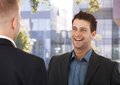 Laughing coworkers outside of office standing business talking Royalty Free Stock Photo