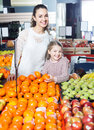 Laughing family customers buying fruits Royalty Free Stock Photo