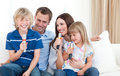 Laughing family singing together Stock Image