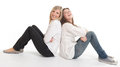 Laughing female friends two young leaning on each other Royalty Free Stock Photography