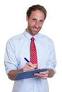 Laughing german businessman with clipboard Royalty Free Stock Photo