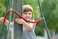 Laughing girl climbing at playground