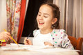 Laughing girl drawing on canvas Royalty Free Stock Photo