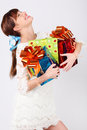 Laughing girl holds boxes with gifts. Stock Photo