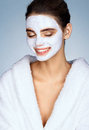 Laughing girl with moisturizing facial mask. Royalty Free Stock Photo