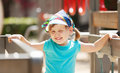 Laughing girl at playground area in sunny day three year Royalty Free Stock Images