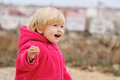 Laughing girl toddler runnung on the walk Stock Image
