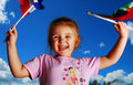 Laughing girl waving flags Stock Images