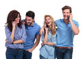 Laughing group of casual people speaking on phone white background Royalty Free Stock Photos