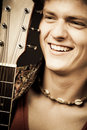 Laughing guitarist Royalty Free Stock Photos