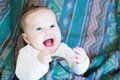 Laughing happy baby under a warm blanket Royalty Free Stock Photo
