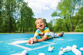 Laughing happy little boy with chalked drawing Royalty Free Stock Photo