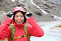 Laughing happy woman hiking with backpack in rain on trek living healthy active lifestyle smiling cheerful girl walking on hike Royalty Free Stock Photo