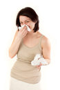 Laughing ill woman sneezing and allergies with tissues Royalty Free Stock Photo