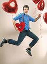 Laughing and jumping man with valentine s balloons guy Royalty Free Stock Photography