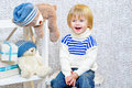 Laughing kid with gift boxes and teddy bears Royalty Free Stock Photo
