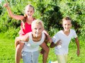 Laughing kids running on grass Royalty Free Stock Photo