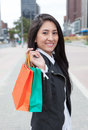 Laughing latin woman with two shopping bags Royalty Free Stock Photo