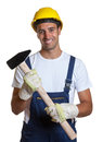 Laughing latin worker with a sledgehammer handsome construction in his hands on white background Stock Image