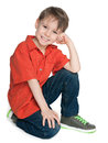 Laughing little boy in the red shirt a is sitting on white background Stock Images