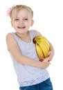 Laughing little girl with a bunch of bananas mouse Royalty Free Stock Photo