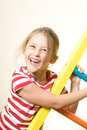 Laughing little girl doing exercises Royalty Free Stock Photography