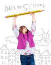 Laughing little girl holding a big pencil with arms up drawing of city in the background back to school concept Royalty Free Stock Photography