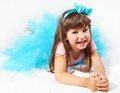 Laughing little girl laying cute studio shot Stock Images