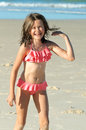 Laughing little girl pretty on holidays at the beach and being happy Royalty Free Stock Photography