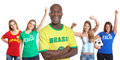 Laughing man from Brazil with four female sports fans Royalty Free Stock Images