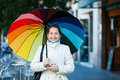 Laughing mature woman with umbrella in autumn Royalty Free Stock Images