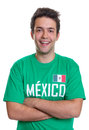 Laughing mexican sports fan with crossed arms from mexico in a green jersey on an isolated white background Stock Photography