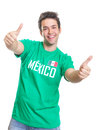 Laughing mexican sports fan showing both thumbs up from mexico with a green jersey on an isolated white background Stock Photos