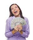 Laughing mixed race woman holding the new one hundred dollar bills excited newly designed united states isolated on a white Stock Photos