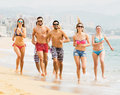 Laughing people running in swimwear Royalty Free Stock Photo