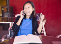 Laughing on the phone asian woman university student talking Royalty Free Stock Photo