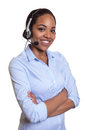 Laughing phone operator with headset and crossed arms Royalty Free Stock Photo
