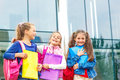 Laughing primary school students with backpacks Stock Photos
