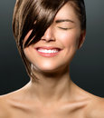 Laughing teenage girl with closed eyes stylish fringe Royalty Free Stock Image
