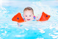 Laughing toddler girl having fun in swimming pool Royalty Free Stock Photo