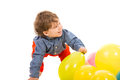 Laughing toddler looking away with colorful balloons to copy space isolated on white background Royalty Free Stock Photos