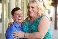 Laughing transgender couple outside Royalty Free Stock Photo