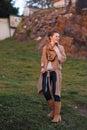 Laughing urban elegant woman walking in evening autumn park Royalty Free Stock Photo