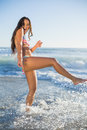 Laughing woman in bikini having fun in the sea on a sunny day Stock Images