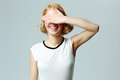 Laughing woman closing her eyes with hand Royalty Free Stock Photo