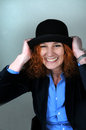 Laughing woman good looking with red hair and black hat Stock Photo