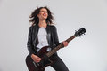 Laughing woman guitarist enjoying herself while playing electric Royalty Free Stock Photo