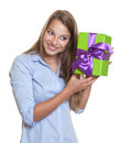 Laughing woman listens on a christmas gift attractive with long blond hair listening white background Stock Images